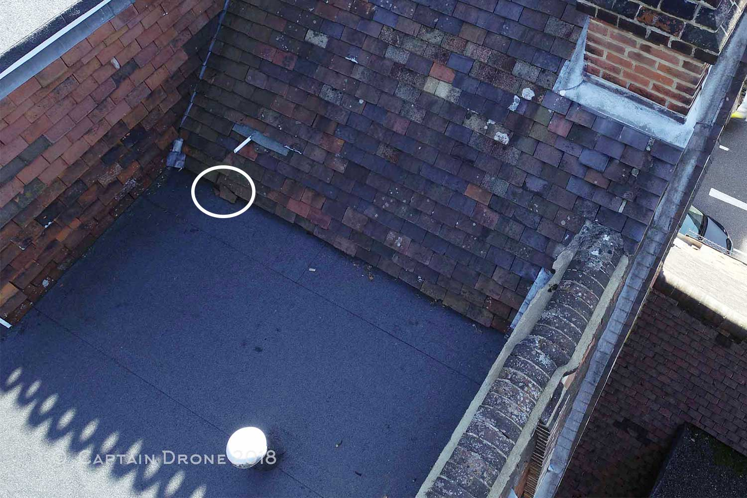 Broken Tile Identified With A Captain Drone Roof Inspection