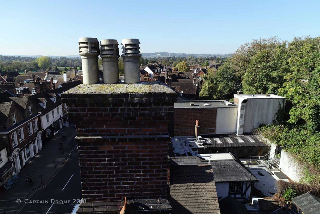 Chimney stack damage shown by a Captain Drone roof inspection